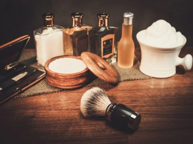 Shaving brush and accessories on wood counter